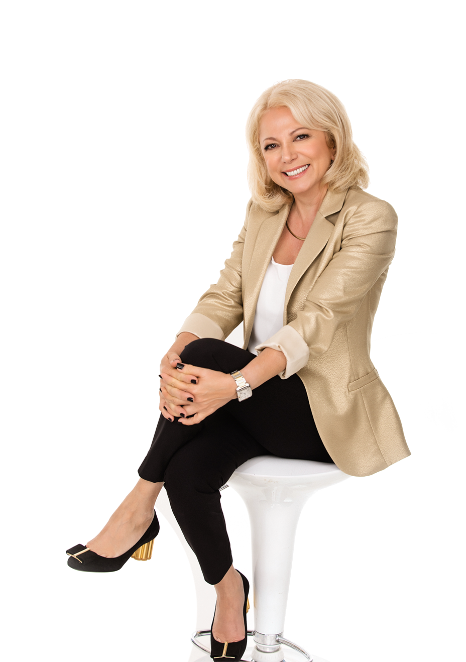 Image Depicting Dori smiling, in a seated position with her hands crossing below her knee