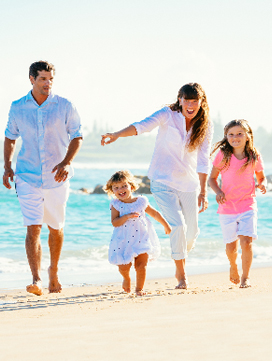 Market image depicting a happy family on the beach